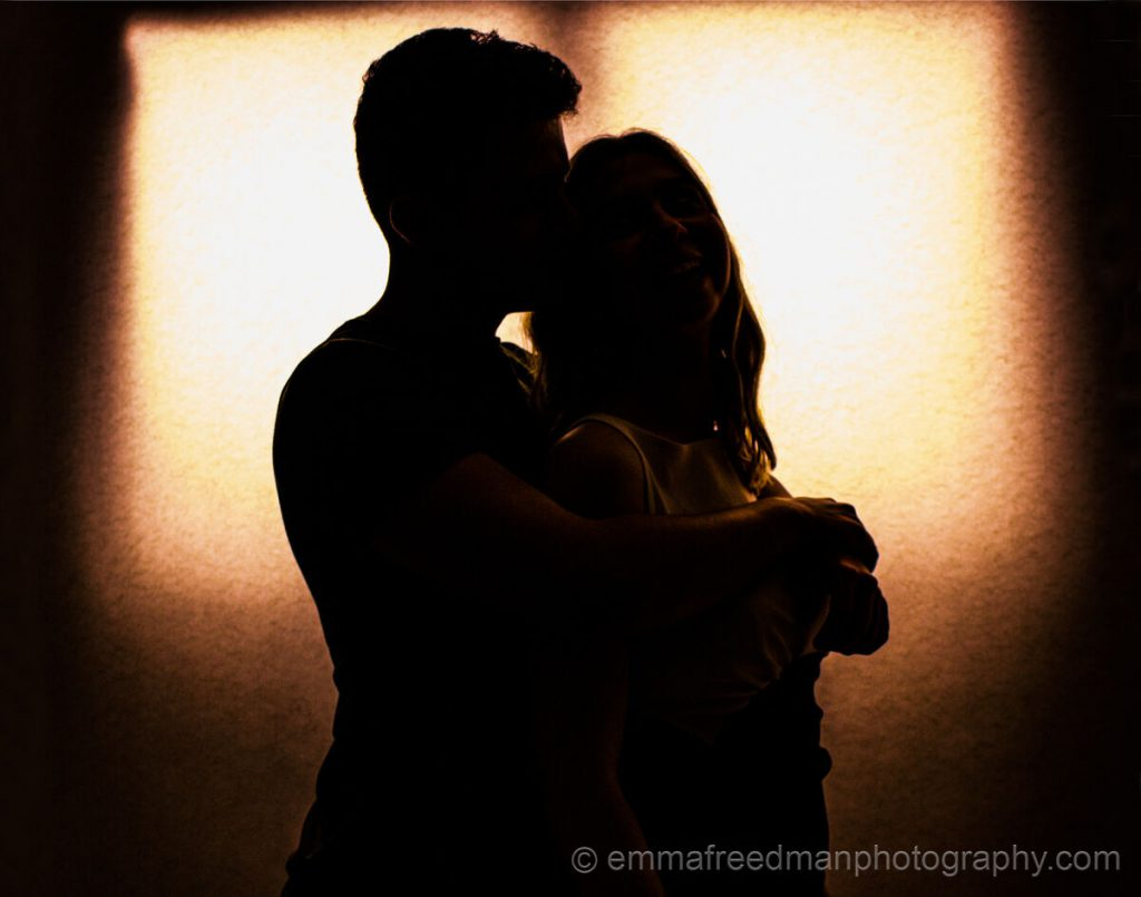Couple in silhouette- hug